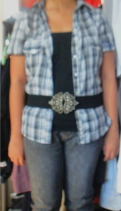 checked grey blouse with jeans and black top and belt